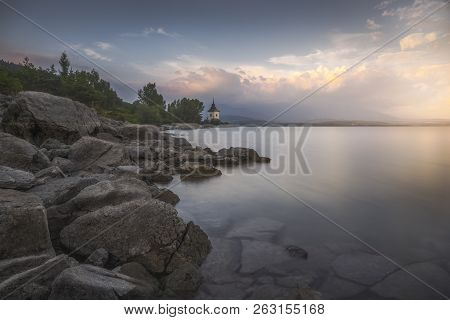 Rocky Beach Of Liptovska Mara Lake In Slovakia At Sunset