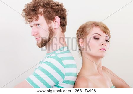 Bad Relationship Concept. Man And Woman In Disagreement. Young Couple After Quarrel Offended Back To