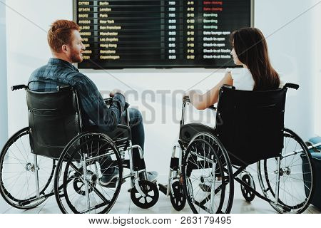 People In Wheelchair. Airport Hall. Woman In Wheelchair. Airport Placards. Limited Opportunities. Wo