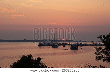 Landscape With Lake, Boats And Sunset Sky At Lake Montauk, New York, Usa