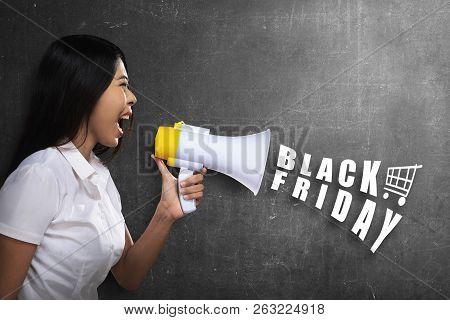 Young Asian Businesswoman Using Megaphone To Announce About Black Friday. Black Friday Concept