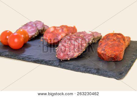 Assortment Of Iberian With Chorizo Served On A Slate Plate