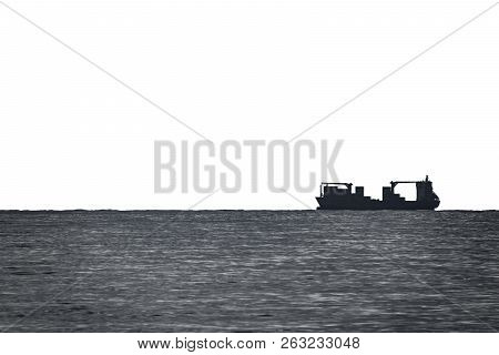 Large Cargo Ship High Contrast On Top Of The Horizon