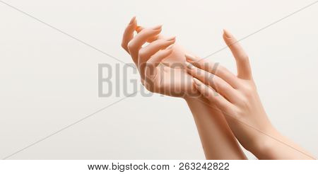 Beautiful Woman Hands. Female Hands Applying Cream, Lotion. Spa And Manicure Concept. Female Hands W