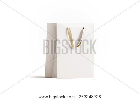 Blank White Paper Gift Bag With Gold Silk Handle Mockup, 3d Rendering. Empty Shopping Packet Mock Up