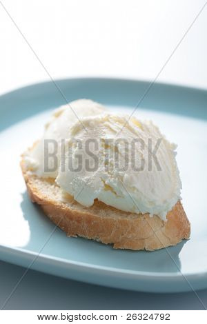 Sandwich with kaymak on the blue plate poster