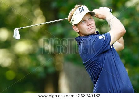 BETHESDA, MD - JULY 1, 2012: Billy Hurley III tees off the 12th hole during the final round of the AT&T National at Congressional Country Club.