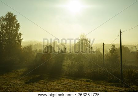 Autumn. Morning Fog Thick. The Village Is Visible Through The Fog. Soft Focus