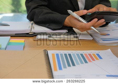 Financial Adviser Working With Calculator At Office. Accountant Doing Accounting & Calculating Reven