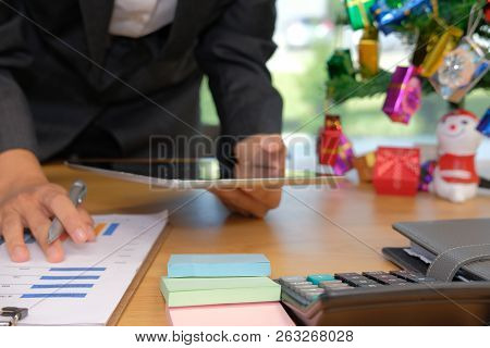 Man Working Organizing Plan With Tablet. Businessman Analyzing Document At Workplace Office During C