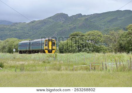 Railway Diesel Train Locomotive In Rural Countryside At Talsarnau, Gwynedd In North Wales Uk.