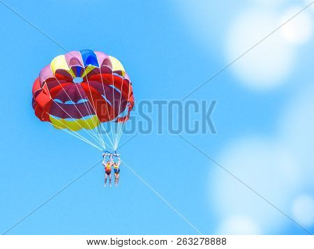 Two Paratroopers Flying Under One Common Parachute