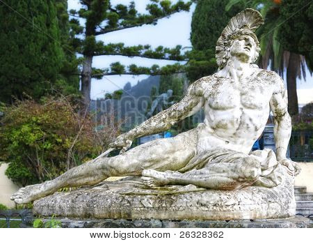 Statue of Achilles dying, shot in the foot with an arrow.  Located in the gardens of the  Achillion Palace, Corfu, Greece. poster