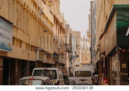 Dubai, Uae - September 09, 2018: People And Cars On The Road At Al Ras District. Deira, Dubai
