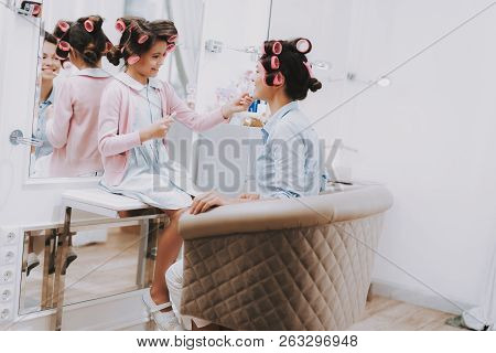 Little Lady With Curlers. Girl With Lipstick. Girl In Beauty Salon. Lipstick In Hands. Consept Beaut