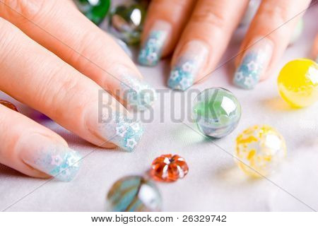 Nails decorated with nice blue enamel.