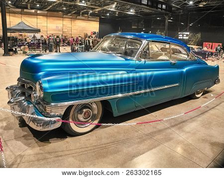Milan, Italy - October 14, 2018: Shot of a vintage car at the East Market in Milan. The East Market is a vintage indoor market led once per month in Milan. They sell vintage dresses, sunglasses, vinyls, food, drinks, furnitures and so on