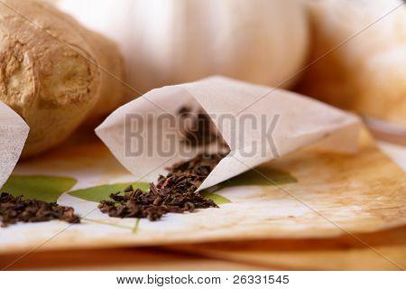 Tea scattered over illustration of herbs