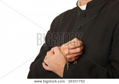 Priest's hands with rosary. Real cassock.