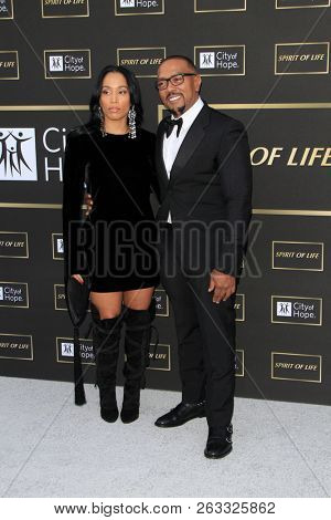 LOS ANGELES - OCT 12:  Monique Idlett, Timbaland at the City of Hope Gala at the Barker Hanger on October 12, 2018 in Santa Monica, CA