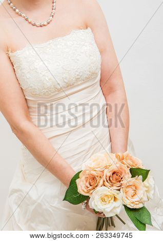 A White Bridal With Pink  Roses Bouquet