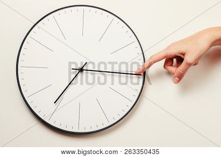Woman Hand Stop Time On Round Clock, Time Management And Deadline Concept
