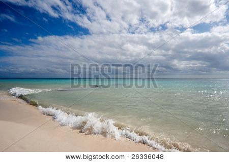 Beautiful beach and  waves of Caribbean Sea. Please search for other beach images in my portfolio - there are lots of them.
