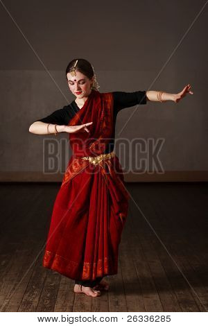 Young woman in sari dancing classical traditional indian dance Bharat Natyam