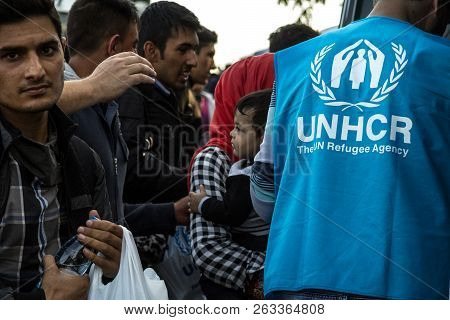 Berkasovo, Serbia - October 10, 2015: Worker Of The Unhcr, The United Nations Agency For Refugees, S