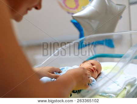 little newborn baby boy with mother. The baby after birth. birth in a hospital