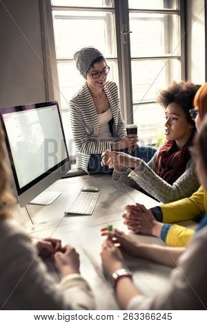 Modern designers office with informal  female employees group