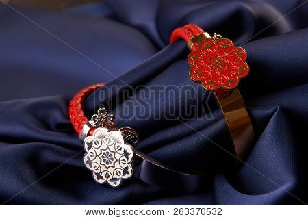 Pair of two Jewelery bijouterie rings on blue silk background poster
