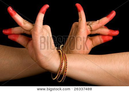 Woman hand showing Katakavardhana hasta of indian classic dance Bharata Natyam