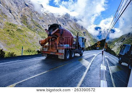 Mountains, Cement Truck And Their Reflection In The Side Of A Campervan