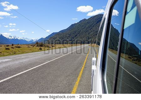 Campervan Parked In A Laybay On A Remote Road