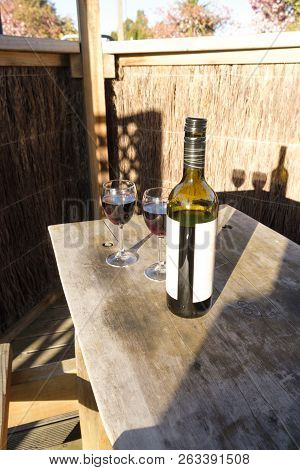 Bottle And Two Glasses Of Red Wine
