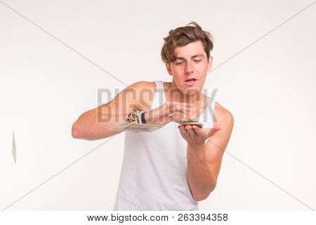 Concept Of Financial Wealth, Prosperity And Lottery Winnings - Man Throwing Away His Money On White