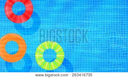 Swim Rings On Swimming Pool Water Background. Inflatable Rubber Toy. Realistic Summertime Illustrati