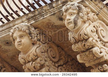 ornamental angels of balcony, Noto, Sicily