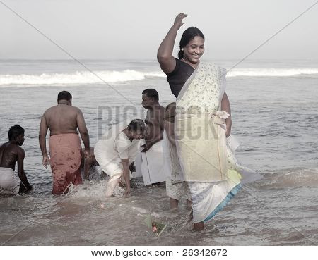 Kerala - July 30: A Hindu Pilgrim Makes An Offering To Her Ancestors On July 30, 2011 In Varkala, Ke