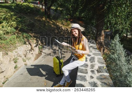 Cheerful Traveler Tourist Woman In Casual Clothes Hat With Suitcase Looking On City Map Sitting On S