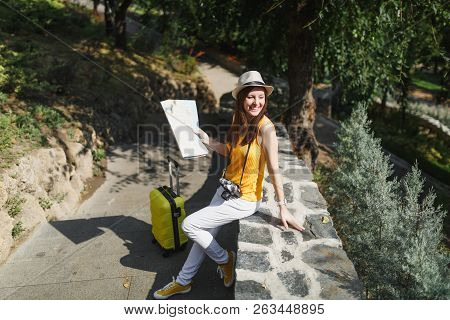 Happy Traveler Tourist Woman In Yellow Clothes Hat With Suitcase City Map Looking Aside Sitting On S