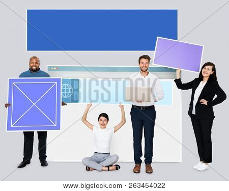 Happy diverse people holding wed design board