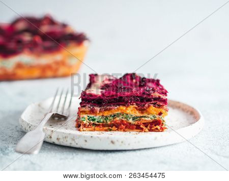 Vegetable Packed Rainbow Lasagne On Craft Plate.ideas And Recipes For Healthy Vegetarian Dinner Or L