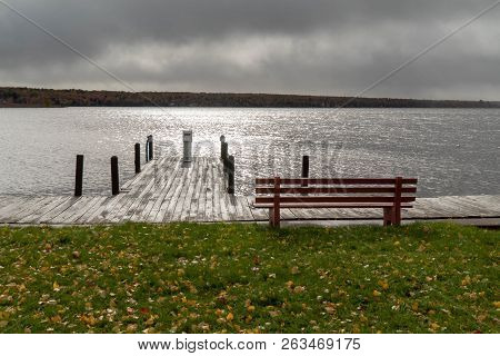 Lake Linden In Upper Peninsula Of Michigan On A Stormy Day Overlooking Boat Dock And Park Bench