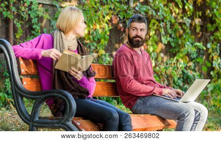 Couple With Book And Laptop Search Information. Use Digital Approach As Well As Books. Man And Woman