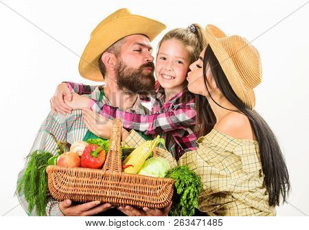 Parents And Daughter Farmers Celebrate Harvest Holiday. Family Farm Concept. Family Farmers Hug Hold