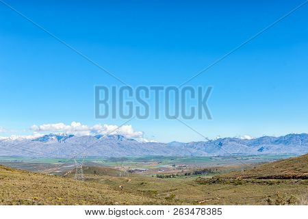 The View From Theronsberg Pass Towards Ceres In The Western Cape Province. Snow Is Visible On The He