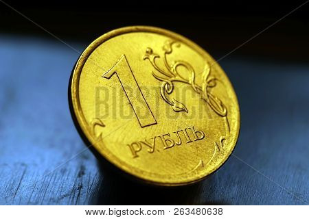 Obverse of Coin one Russian Ruble, New Russian Coin - One Rouble, Russian Ruble on the Coin Background, Shiny Silver Coin of One Ruble (Rouble) as a Symbol of Russian Currency poster