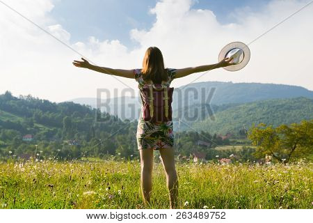 Girl In Vacation. Summer Vacation. Traveler Girl Walking Through Fields. Young Girl Traveler Walking